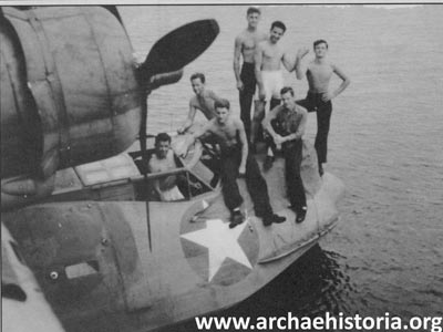 Plane 6 of Patrol Squadron Forty-Four (44-P-6) and crew at Vanikoro Island in the Santa Cruz Group of the Eastern Solomons.